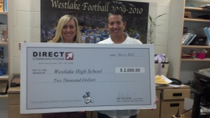 Sharon Mardesich and Mike oConnor of Westlake High School with a check from Direct Communications