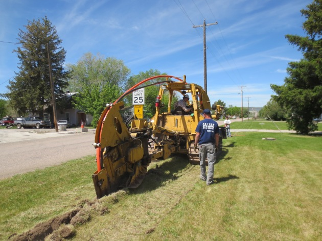 Plowing in conduit for fiber optic cable along Center street