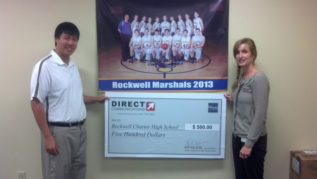 Diane Bradshaw presents a donation to Coach Maw of Rockwell High School