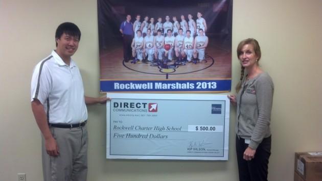 Diane Bradshaw presents a donation to Coach Maw of Rockwell High School