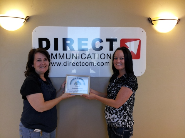 Rockwell High presents Direct Communications with a certificate of appreciation