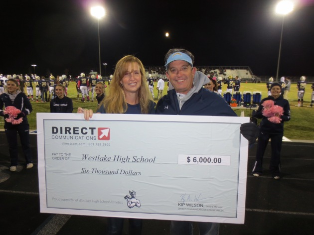 Diane Bradshaw of Direct Communications presents a donation to Westlake High School Athletic Director Michael O'Connor for the athletic program. (Not pictured, but our thanks also to: Sharon Mardesich, athletic assistant.)