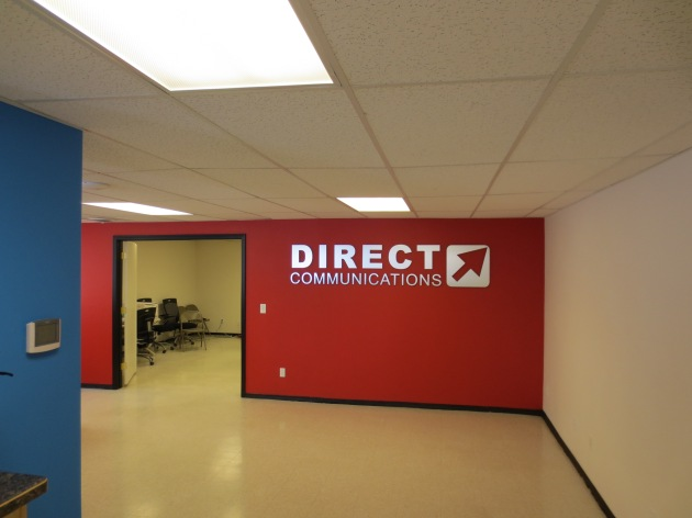 The finished logo signage on the back wall in our Paris office.