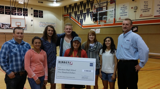 Aberdeen High School student athletes accept a sponsorship check for $500 from Direct Communications. — with Daniel Parrish at Aberdeen High School.