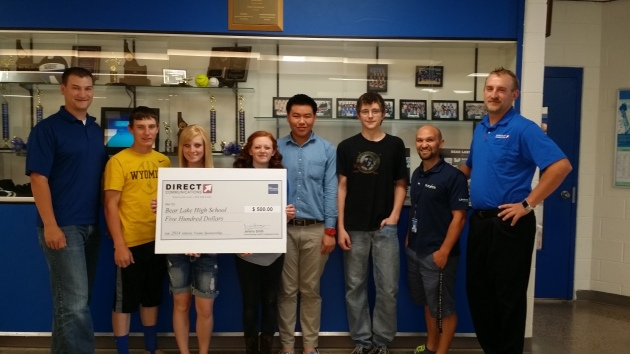 Bear Lake High School student athletes and staff accept a sponsorship check for $500 from Direct Communications.