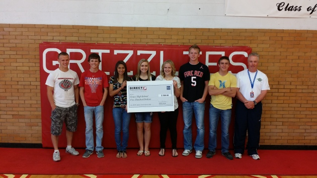 Daniel Parrish presents Grace High School athletes with a sponsorship check for $500.