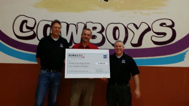 Daniel Parrish presents North Gem High School athletes with a sponsorship check for $500.  - in Bancroft Idaho